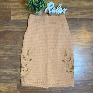 Anthropologie tan midi skirt with details on side